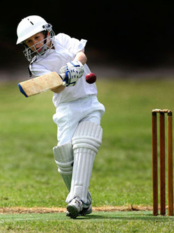 Young cricketer in action
